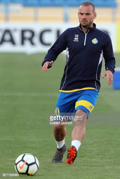 Qatar's alGharafa Dutch captain Wesley Sneijder attends a training session with his teammates on the eve of their AFC Champions League match against...