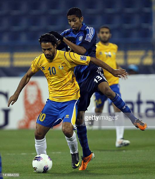 Qatar's AlGharafa Iranian player Farhad Majidi competes with Salman alFaraj of Saudi Arabia's AlHilal club during their Group D AFC Championship...