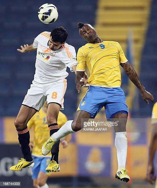 Qatar's al-Gharafa player Djibril Cisse fights for the ball with Fernando of Saudi Arabia's al-Shabab during their AFC Champions League soccer match...
