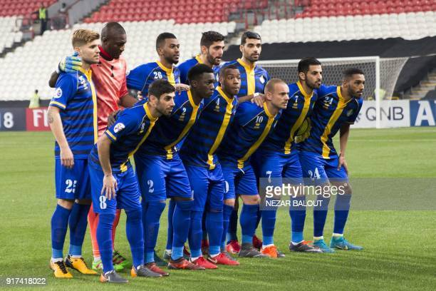 Qatar's alGharafa pose for a group photo ahead of the AFC Champions League Round 1 Group Match between alJazira vs alGharafa at the Mohammed Bin...