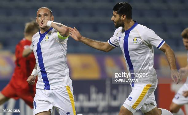 Qatar's alGharafa's Dutch captain Wesley Sneijder celebrates after scoring a goal against Uzbekistan's Pakhtakor during a match qualifying for AFC...