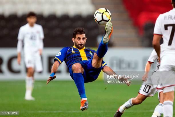Qatar's alGharafa's Fahid AlShammari kicks the ball during the AFC Champions League Round 1 Group Match between alJazira vs alGharafa at the Mohammed...
