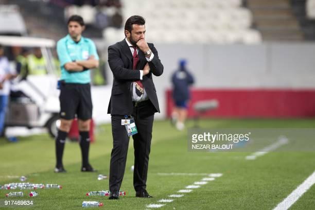 Qatar's alGharafa's head coach Turkish Bulent Uygun reacts during the AFC Champions League Round 1 Group Match between alJazira vs alGharafa at the...