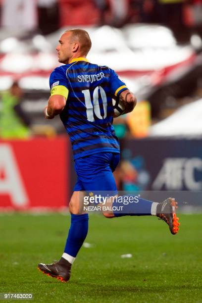 Qatar's alGharafa's Wesley Sneijder celebrates after scoring during the AFC Champions League Round 1 Group Match between alJazira vs alGharafa at the...
