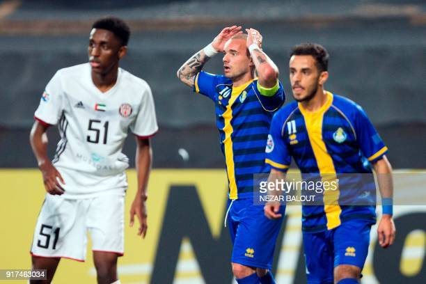Qatar's alGharafa's Wesley Sneijder reacts during the AFC Champions League Round 1 Group Match between alJazira vs alGharafa at the Mohammed Bin...
