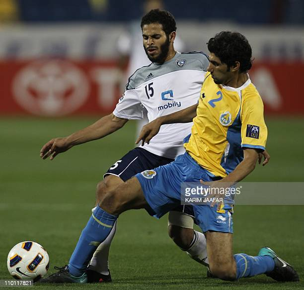 Qatar's alGharrafa player Ibrahim Al Ghanem vies for the ball against Saudi's alHilal player Ahmed alFraidi during their AFC Champions League soccer...