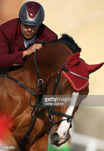 Qatar's Ali alRumaihi clears an obstacle with his horse during the 11th PanArab Games in Cairo 13 November 2007 The Games are a regional multisport...