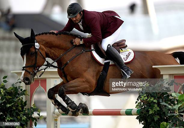 Qatar's Ali alRumaihi competes with Ravenna 323 in the individual jumping equestrian final at the 2011 Arab Games in the Qatari capital Doha on...