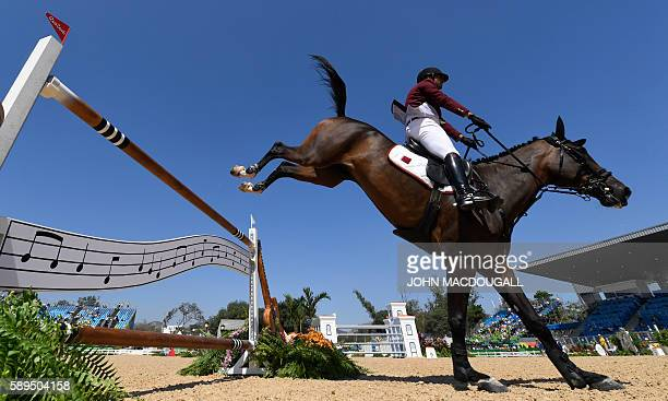 Qatar's Ali Yousef Al Rumaihi on Gunder competes during the Equestrian's Show Jumping first qualifier event of the 2016 Rio Olympic Games at the...