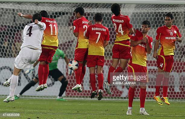 Qatar's AlJaish player Anderson Martins takes a free kick as Foolad Khouzestan players try to defend during their AFC Champions League group B...