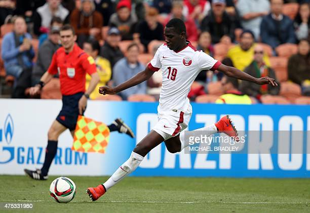 Qatar's Almoez Ali shoots during the FIFA Under20 World Cup football match between Qatar and Colombia in Hamilton on May 31 2015 AFP PHOTO / Michael...