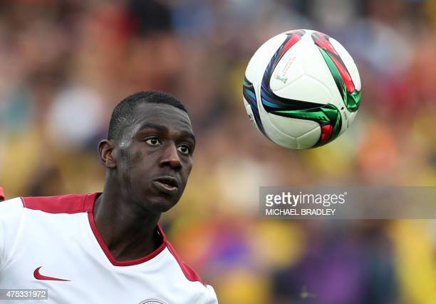 Qatar's Almoez Ali watches the ball during the FIFA Under20 World Cup football match between Qatar and Colombia in Hamilton on May 31 2015 AFP PHOTO...