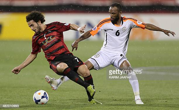 Qatar's AlRayyan player Ahmed Alaedin fights for the ball with Omar AlGhamdi of Saudi Arabia's AlShabab during their AFC Champions League football...
