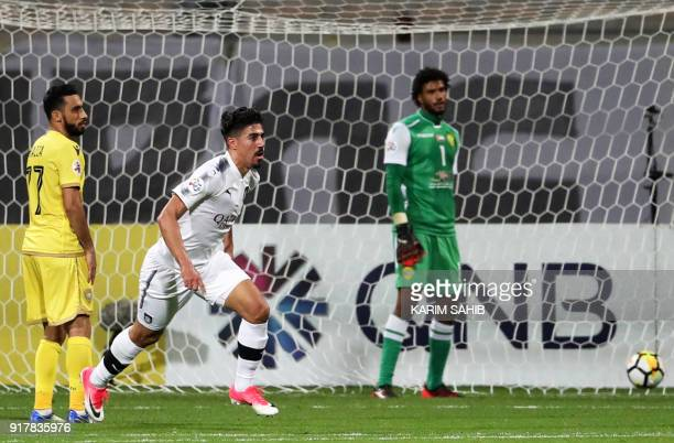 Qatar's alSadd player Baghdad Bounedjah celebrates after scoring a goal during the AFC Champions League group stage football match between alWasl and...