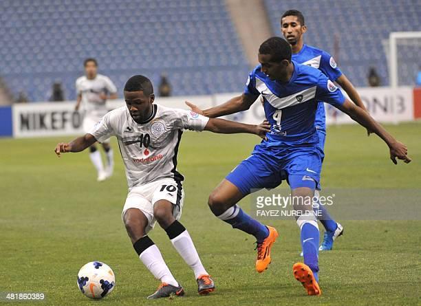 Qatar's Al-Sadd player Khalfan Ibrahim fights for the ball against Saudi's Al-Hilal player Abdullah Al-Zoari during their AFC Champions League group...