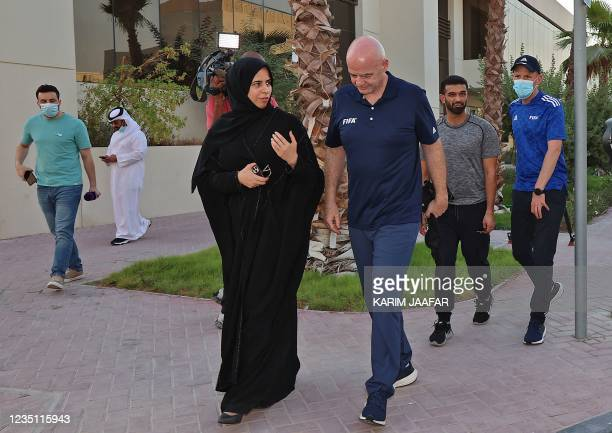 Qatars assistant Foreign Minister Lolwah al-Khater and FIFA president Gianni Infantino talk as they walk at Park View Villas, a Qatar's 2022 FIFA...