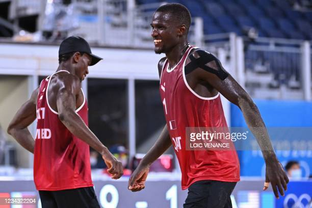 Qatar's Cherif Younousse and partner Ahmed Tijan celebrates winning their men's preliminary beach volleyball pool C match between Qatar and the USA...