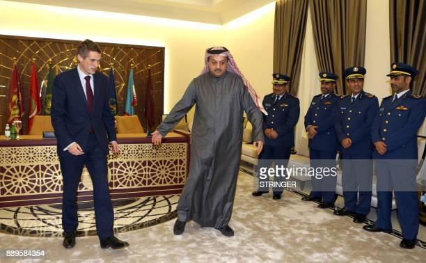Qatar's Defence Minister Khalid bin Mohammed alAttiyah receives his British counterpart Gavin Williamson in the capital Doha on December 10 as Qatar...