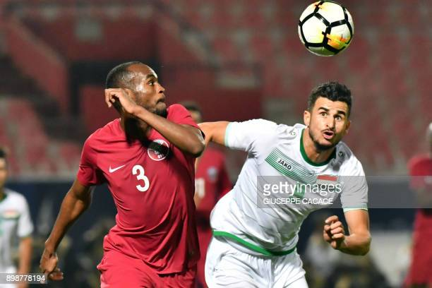 Qatar's defender Abdelkarim Hassan vies for the ball against Iraq's Ayman Hussein Ghadhban during their 2017 Gulf Cup of Nations group match at Al...