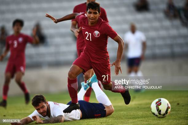 Qatar's defender Ali Karami vies with England's forward Adam Armstrong during the Maurice Revello tournament Under 20 football match between England...