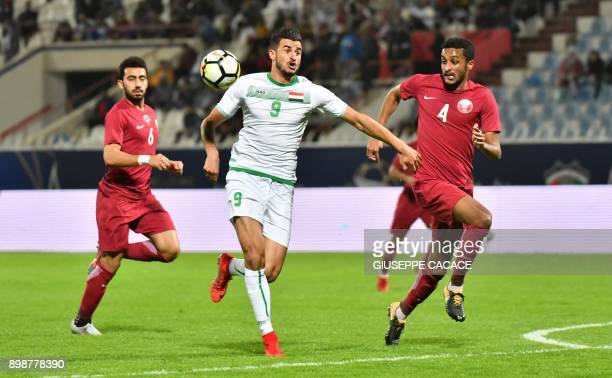 Qatar's defender AlMahdi Ali Mukhtar vies for the ball against Iraq's Ayman Hussein Ghadhban during their 2017 Gulf Cup of Nations group match at Al...