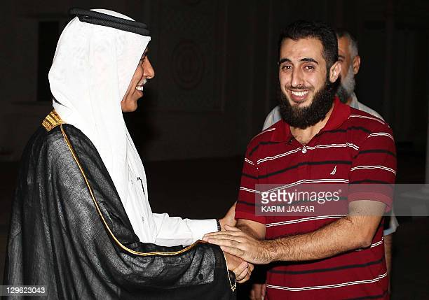 Qatar's Deputy Prime Minister and Minister of State for Cabinet Affairs Ahmed bin Abdullah alMahmud welcomes one of 15 freed Palestinian prisoners at...