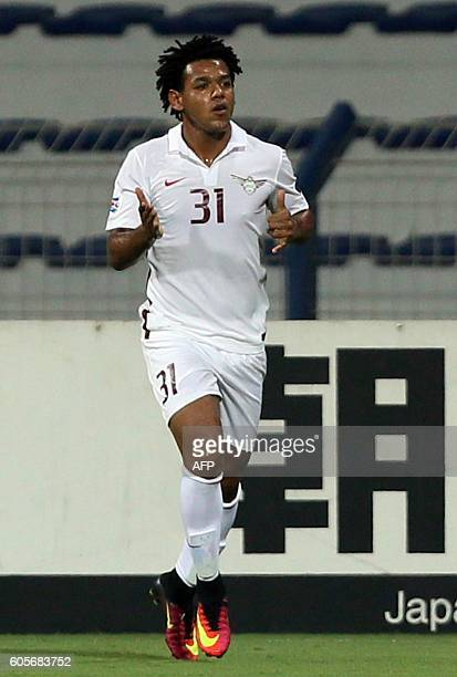 Qatar's ElJaish club player Romarinho Ricardo celebrates after scoring a goal during their Asian Champions League quarterfinal football match against...