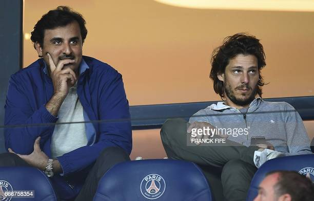 Qatar's Emir and Paris SaintGermain owner Tamim bin Hamad AlThani and Argentinian former tennis player Gaston Gaudio attend the French L1 football...