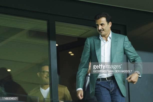 Qatar's Emir and Paris SaintGermain owner Tamim bin Hamad AlThani attends the UEFA Champions league Group A football match between Paris SaintGermain...