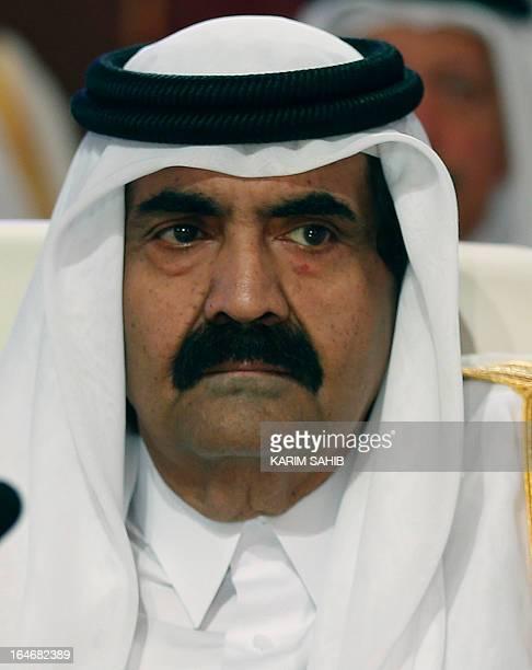 Qatar's Emir Hamad bin Khalifa alThani attends the opening of the Arab League summit in the Qatari capital Doha on March 26 2013 The Arab League...
