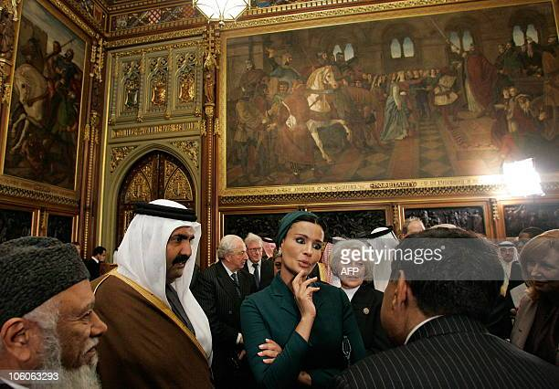 Qatar's emir Sheikh Hamad bin Khalifa alThani and his wife Sheikha Mozah meet members of the All Party Parliamentary BritishQatar Group during his...