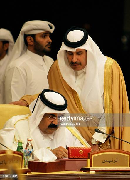 Qatar's Emir Sheikh Hamad bin Khalifa al-Thani and Prime Minister Hamad bin Jassem bin Jabr al-Thani attend a crisis summit meeting on Gaza in the...