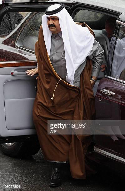 Qatar's Emir, Sheikh Hamad bin Khalifa al-Thani, arrives to be geeted by Britain's Queen Elizabeth II, at the Royal Dias in Windsor, west of London,...