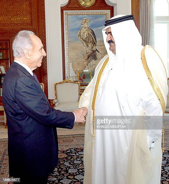 Qatar's Emir Sheikh Hamad bin Khalifa alThani greets Israel's Deputy Prime Minister Shimon Peres in Doha 30 January 2007 Peres flew to the Gulf state...