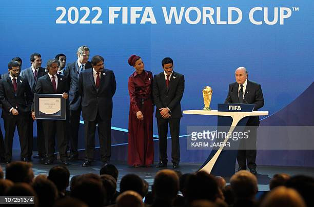 Qatar's Emir Sheikh Hamad bin Khalifa alThani his wife Sheikha Moza and their son Sheikh Mohammed bin Hamad alThani chairman of the Qatar 2022 bid...
