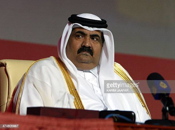 Qatar's Emir Sheikh Hamad bin Khalifa alThani looks on during the opening of the threeday 14th International Conference Exhibition on Liquefied...