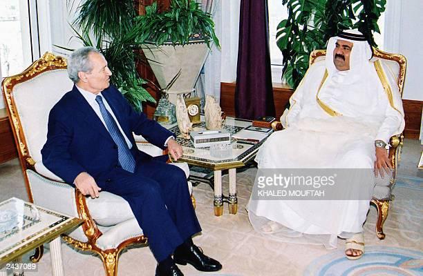 Qatar's emir Sheikh Hamad bin Khalifa alThani meets with Syrian Foreign Minister Faruq alShara in Doha 26 August 2003 Shara who is on a Gulf tour...