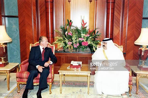 Qatar's emir Sheikh Hamad bin Khalifa alThani receives King Juan Carlos I of Spain at his palace in Doha 23 October 2003 The Spanish monarch and his...