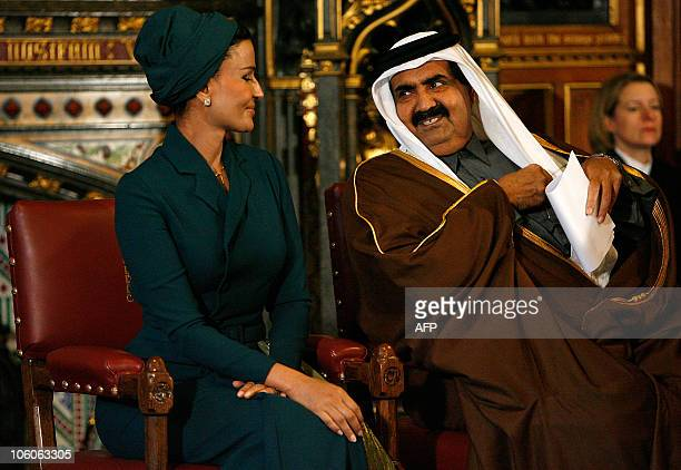 Qatar's emir Sheikh Hamad bin Khalifa alThani sits with his wife Sheikha Mozah before addresing the All Party Parliamentary BritishQatar Group during...