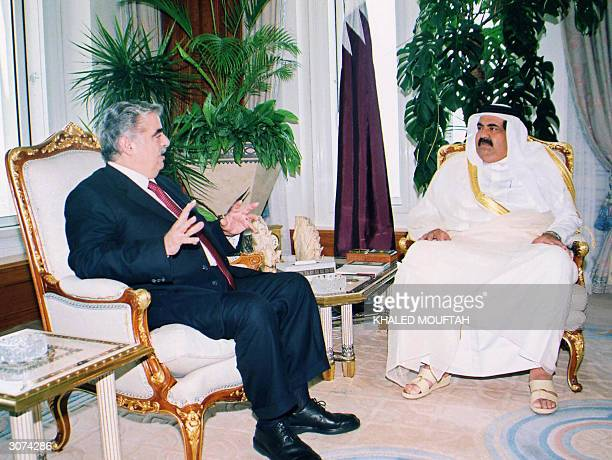Qatar's Emir Sheikh Hamad bin Khalifa alThani sits with Lebanon's Prime Minister Rafiq Hariri during a meeting in Doha 11 March 2004 Hariri is on an...