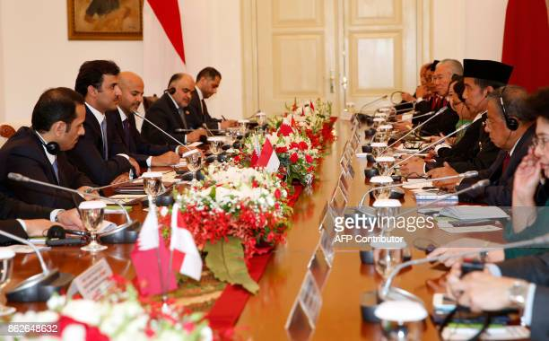 Qatar's Emir Sheikh Tamim Bin Hamad alThani and Indonesian President Joko Widodo attend a bilateral meeting at the presidential palace in Bogor West...