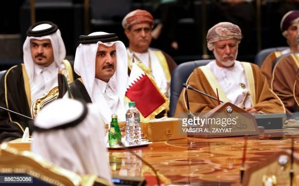 Qatar's Emir Sheikh Tamim bin Hamad AlThani and Omani Foreign Minister Yusuf bin Alawi bin Abdullah attend the Gulf Cooperation Council summit at...