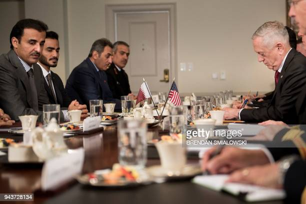 Qatar's Emir Sheikh Tamim Bin Hamad AlThani and US Secretary of Defense James Mattis wait for a meeting at the Pentagon April 9 2018 in Washington DC...