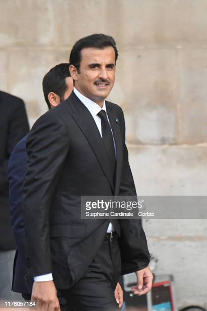 Qatar's Emir Sheikh Tamim bin Hamad Al-Thani arrives to attend a church service for former French President Jacques Chirac at Eglise Saint-Sulpice on...