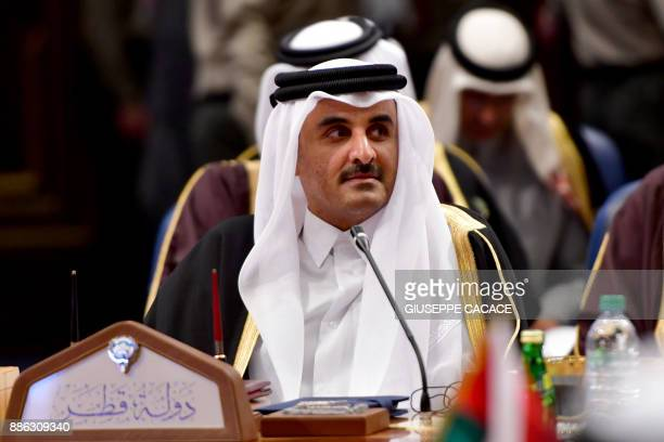 Qatar's Emir Sheikh Tamim bin Hamad AlThani attends the Gulf Cooperation Council summit at Bayan palace in Kuwait City on December 5 2017 Giuseppe...