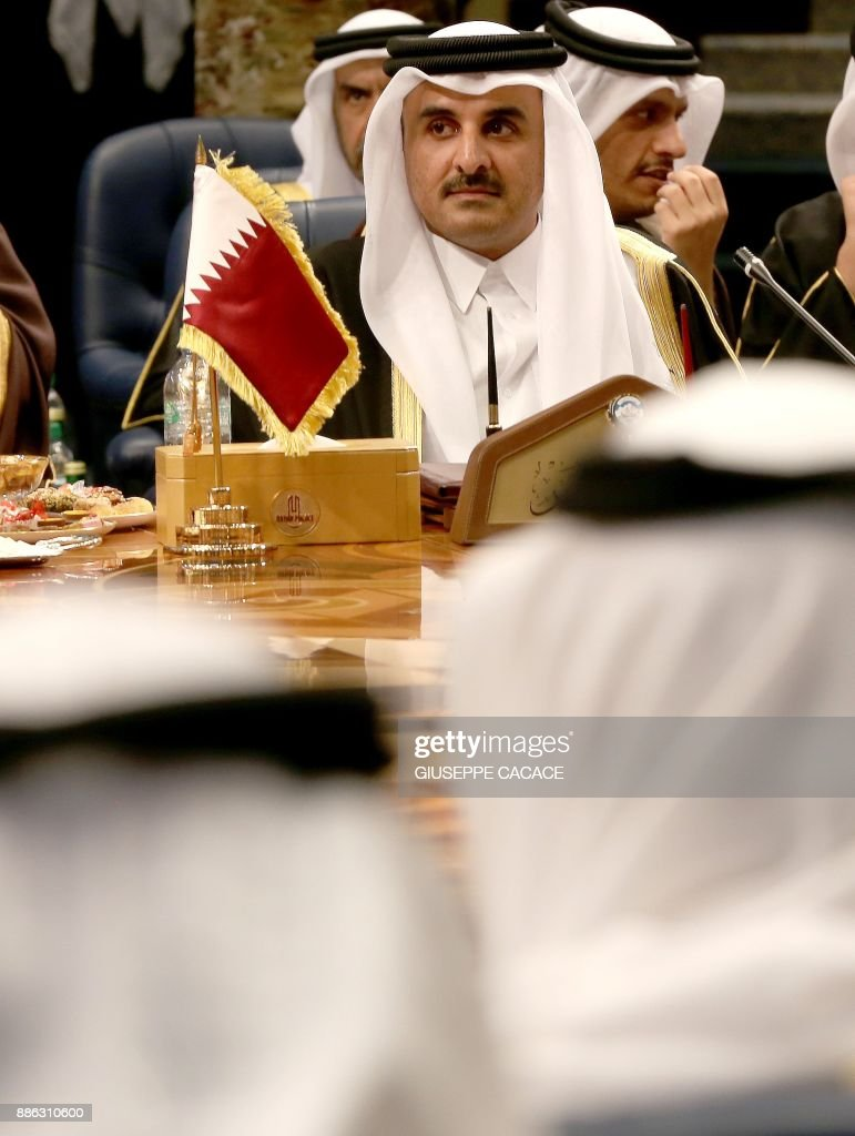 Qatar's Emir Sheikh Tamim bin Hamad al-Thani attends the Gulf Cooperation Council (GCC) summit at Bayan palace in Kuwait City on December 5, 2017. The Gulf Cooperation Council, which launches its annual summit today in Kuwait amid its deepest ever internal crisis, comprises six Arab monarchies who sit on a third of the world's oil. A political and economic union, the GCC comprises Saudi Arabia, the United Arab Emirates, Kuwait, Qatar, Oman and Bahrain. Dominated by Riyadh, it is a major regional counterweight to rival Iran. CACACE