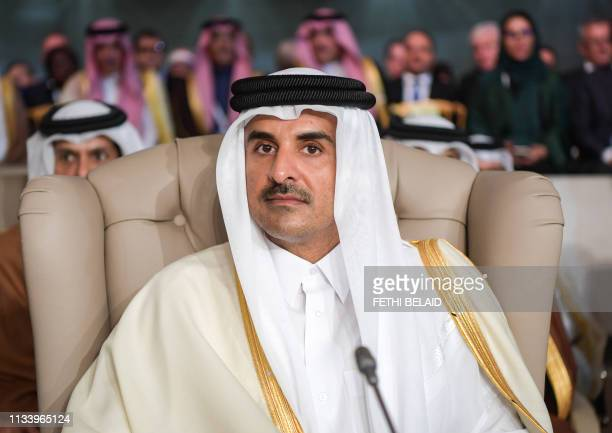 Qatar's Emir Sheikh Tamim bin Hamad AlThani attends the opening session of the 30th Arab League summit in the Tunisian capital Tunis on March 31 2019