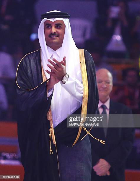 Qatar's Emir Sheikh Tamim bin Hamad alThani claps as French players celebrate during the podium ceremony of 24th Men's Handball World Championships...