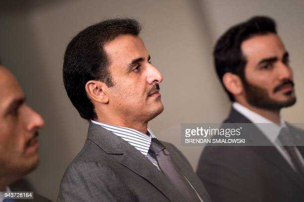 Qatar's Emir Sheikh Tamim Bin Hamad AlThani listens while US Secretary of Defense James Mattis speaks before a meeting at the Pentagon April 9 2018...