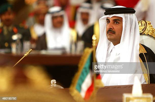 Qatar's Emir Sheikh Tamim bin Hamad AlThani looks on during the Gulf Cooperation Council summit in Doha on December 9 2014 Leaders of energyrich Gulf...